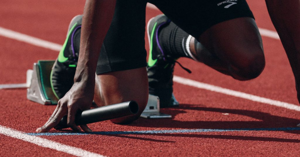 5 actions every new sales leader must take in their first 30 days (photo of a sprinter along on the track) Photo by Braden Collum on Unsplash