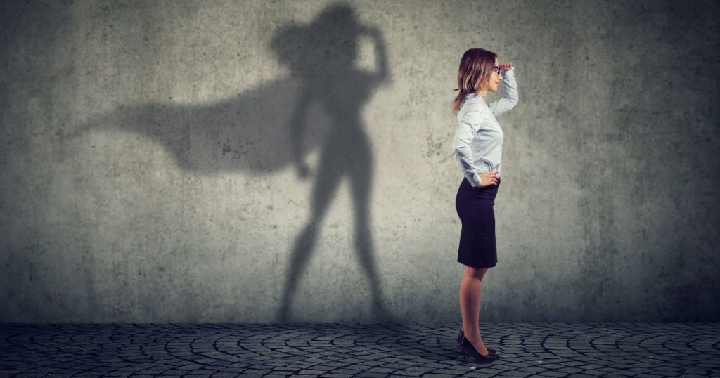 How to be a profit hero (photo of saleswoman with a superhero shadow)